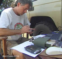 Transferring wildlife data to a laptop.